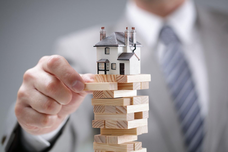 miniature house on building blocks
