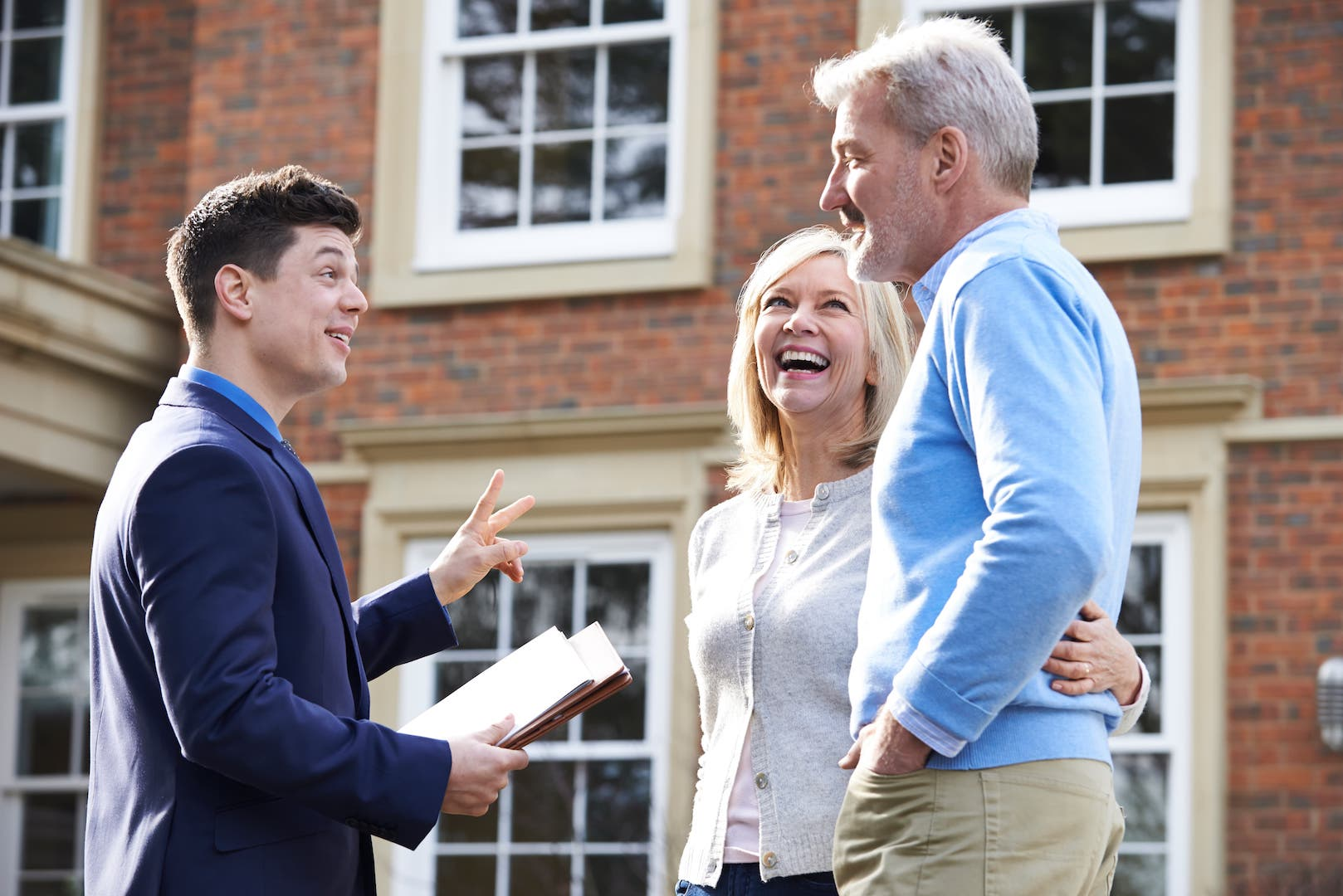 couple talking to realtor