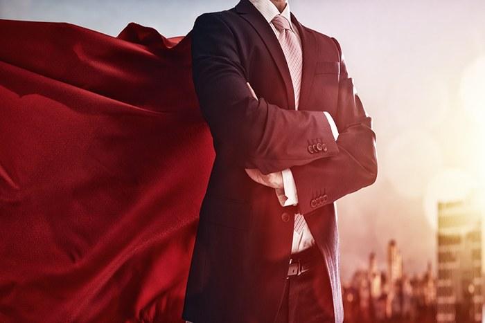 man in suit and superhero cape
