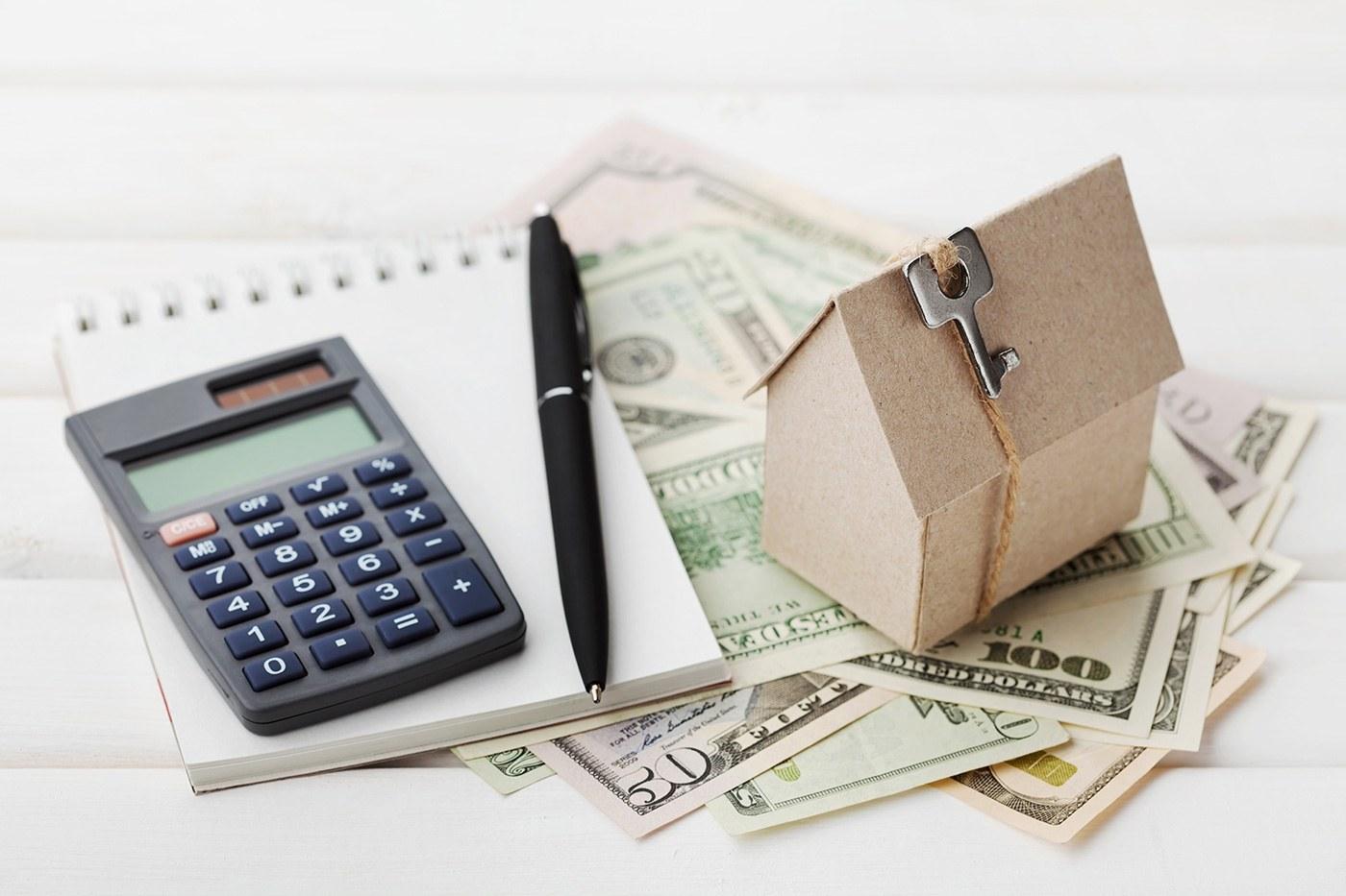 calculator pen money notepad