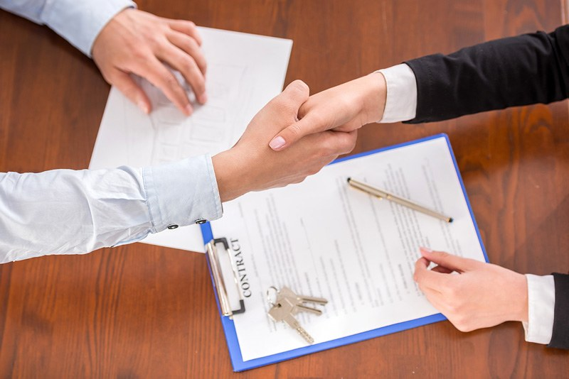 signed contract and handshake